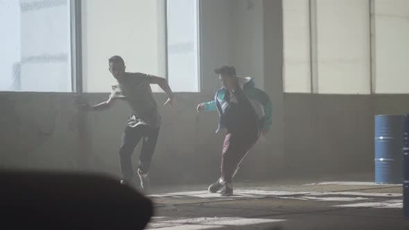 Thumbnail for Two Boys Dancing in Front of the Large Window in Abandoned Building