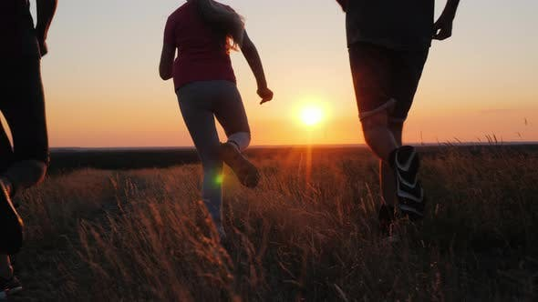 Thumbnail for A Young Family with a Child Makes an Evening Jog in Nature