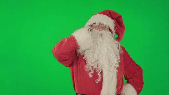 Thumbnail for Santa Talking on His Cellphone with a Surprised Look on His Face. on a Green Screen Chrome Key