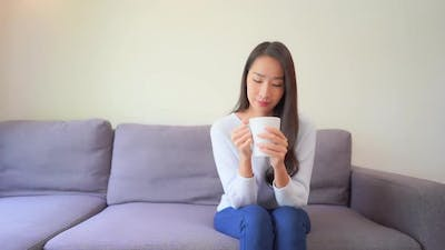 Young asian woman with coffee cup