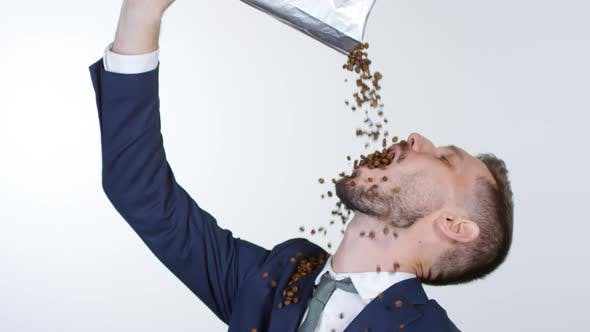 Cover Image for Sleep-Deprived Businessman Pouring Coffee Beans into his Mouth
