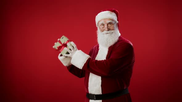 Thumbnail for Portrait of Santa Claus Holding Christmas Present