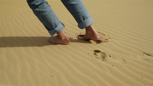 Thumbnail for Feet Stepping on Sand Dunes