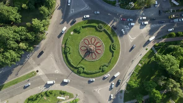 Thumbnail for Aerial View of Roundabout Road with Circular Cars in Small European City at Sunny Day