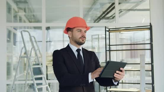 Thumbnail for Bearded Manager of Building Company in Hardhat which Inspecting New Office Building