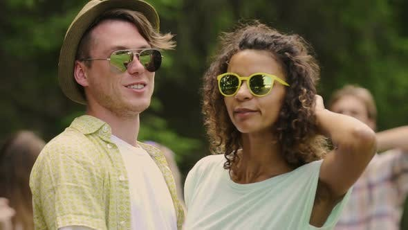 Thumbnail for Slowmotion of Young Couple in Sunglasses Smiling to Camera, Happy People Hugging