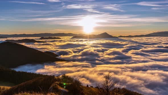 Peaceful Sunny evening in Mmountains Nature with Foggy Clouds Flows at Autumn Sunset Lanscape