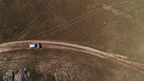 Aerial Footage Filmed with Drone of Pickup Car Riding in Steppe