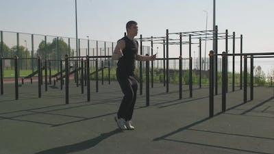Man Jumping Skipping Rope Outdoors