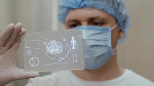 Doctor with Futuristic Hologram Hud Screen Tablet