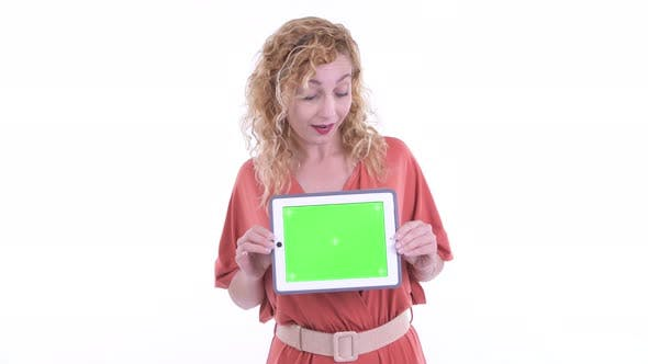 Thumbnail for Happy Beautiful Blonde Businesswoman Thinking While Showing Digital Tablet