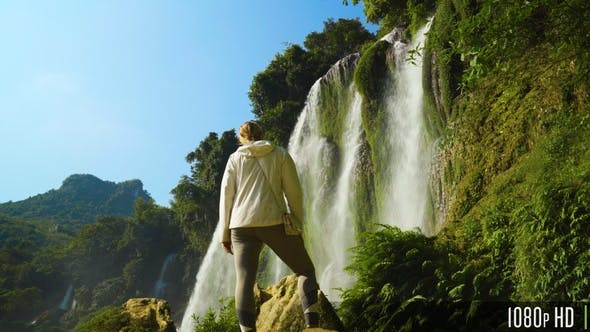 Thumbnail for Back of Young Woman in Front of Waterfall in the Mountains of Vietnam