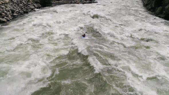 Thumbnail for Slow Motion Aerial Of Kayaker Catching Air On White Water Rapid Hydraulic In Class V River