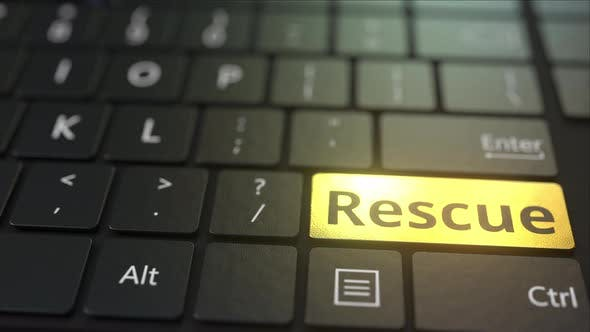Thumbnail for Black Computer Keyboard and Gold Rescue Key