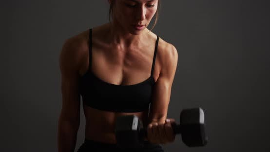 Thumbnail for Strong healthy woman lifting weights