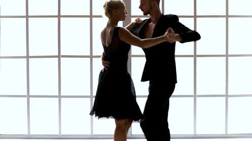 Couple in Black Costumes Dancing Contemporary Dance