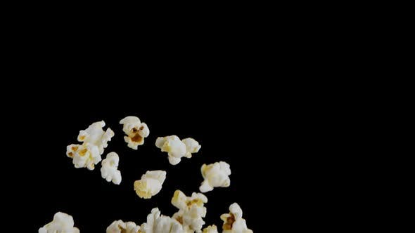 Popping Popcorn Flying and Falling Isolated on Black Background