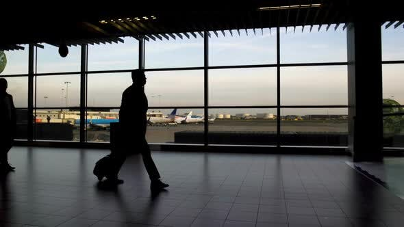 Thumbnail for Men and Women with Bags Walking at Airport Terminal, Traveling and Vacation