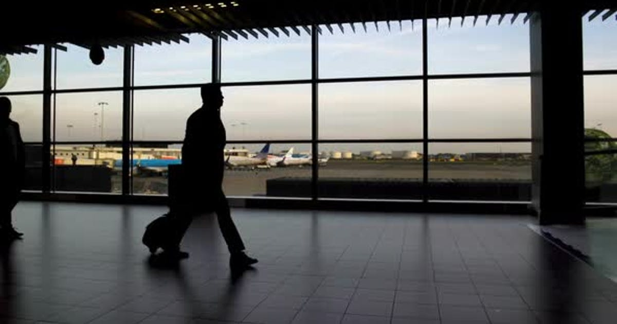 Men and Women with Bags Walking at Airport Terminal, Traveling and Vacation