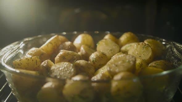 Fast Baking of Golden Potato in the Oven, Timelapse Shot