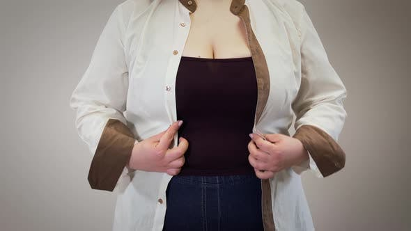 Thumbnail for Unrecognizable Caucasian Fat Woman Fastening Shirt. Obese Adult Girl Having Overweight Problems