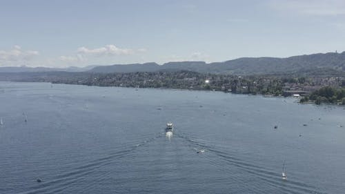 4k ungraded drone Aerial view of Zurich  city waterfront in Switzerland