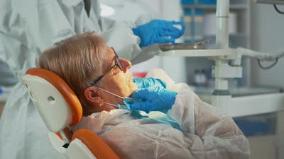 Dentist Technician in Coverall Drilling Woman Tooth