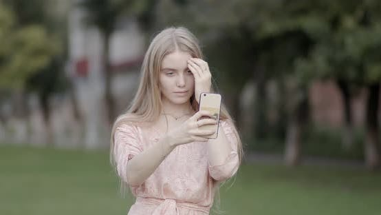 Thumbnail for Beautiful girl, blonde, makes a selfie on the phone