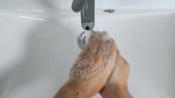 Thumbnail for Young Man Washing Hands in Bathroom at Home