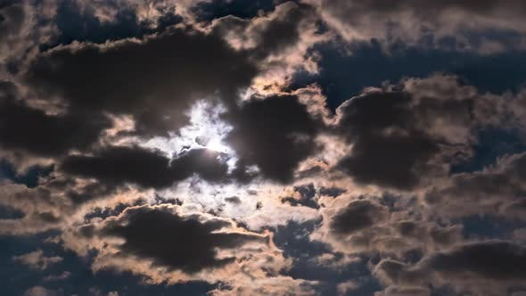 Thumbnail for The Full Moon Rises in the Night Sky Over Dark Clouds, Timelapse