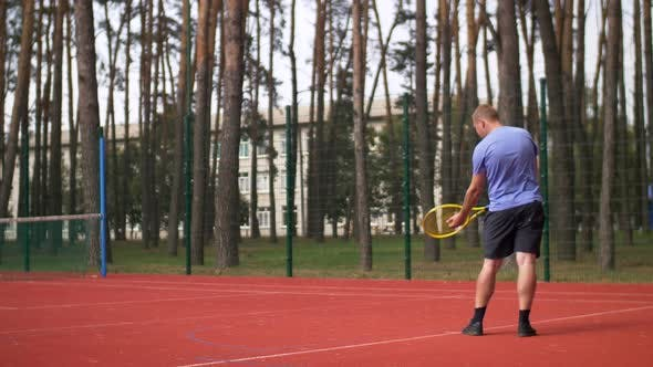 Thumbnail for Active Sporty Male Tennis Player Serving a Ball