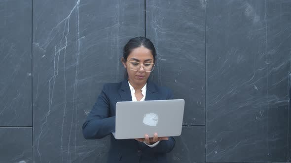 Thumbnail for Focused Pretty Latin Businesswoman Working Outside