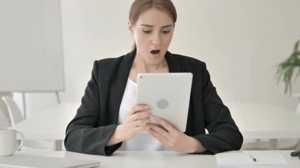 Cover Image for Young Businesswoman Reacting to Loss on Tablet