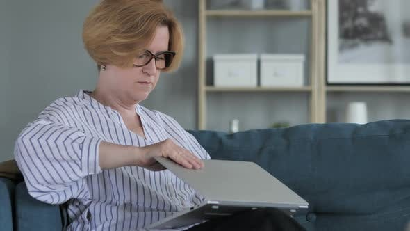 Thumbnail for Old Senior Woman Leaving Couch after Completing Work on Laptop