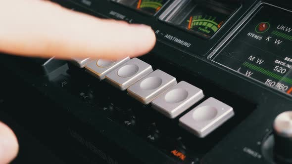 Thumbnail for Pushing Play, Stop, Rec, Ff, Rew Buttons on a Tape Recorder