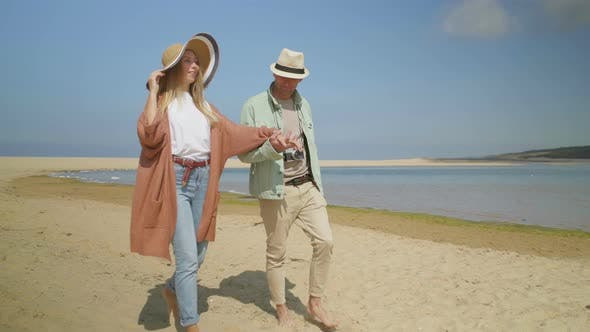 Thumbnail for Couple Holding Hands and Walking on Beach