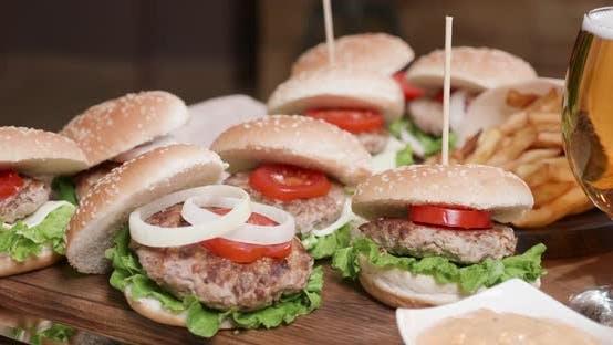 Thumbnail for Closeup Shot of Beautiful Plateau of Burgers in a Restaurant