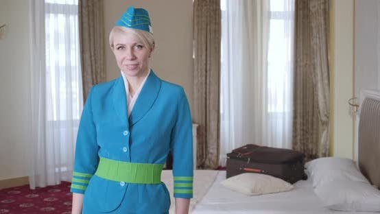 Thumbnail for Portrait of Confident Woman in Blue Stewardess Uniform Posing in Hotel Room, Elegant Beautiful