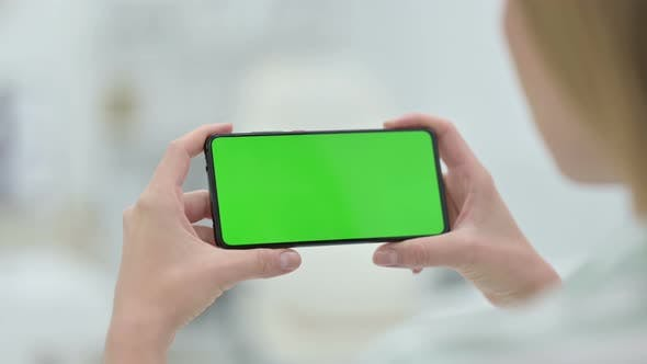 Thumbnail for Woman Watching Smartphone with Green Key Chroma Screen