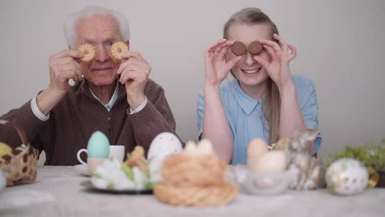 Thumbnail for Senior Man Smiling. Chererful Grandfather and Granddaughter Playing with Cakes and Smile.
