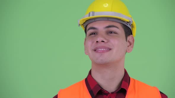 Cover Image for Face of Happy Young Multi Ethnic Man Construction Worker Thinking
