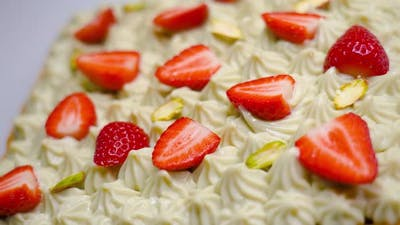 Tasty Cake with Cream and Strawberries