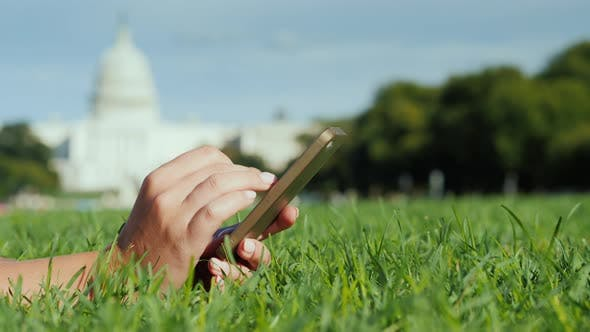 Thumbnail for On the Lawn, Against the Background of the Capitol in Washington