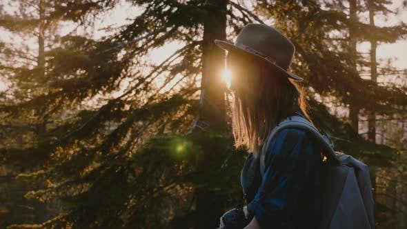 Thumbnail for Side View Close Up Shot of Tired Tourist Girl with Long Hair Walking on Forest Road on Sunset