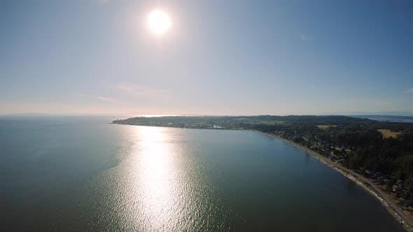 Sunny Summer Day Aerial Over Coastal Ocean Town