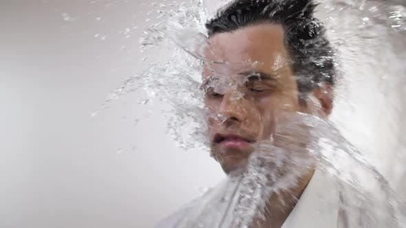 Water Splash on Face of a Man