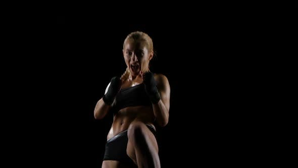 Cover Image for Punches and Kicks By Delightful Athlete Girl Boxer. Slow Motion