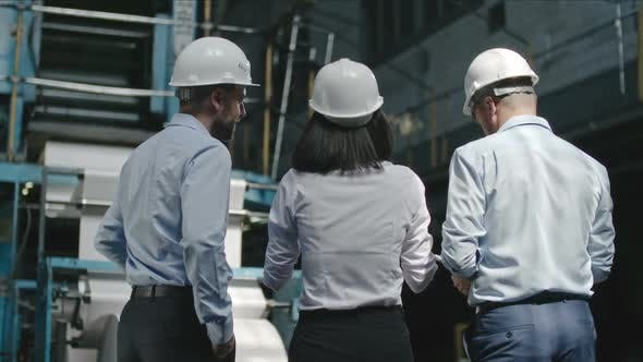 Thumbnail for Factory Supervisors Inspecting Workshop