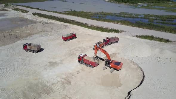 Thumbnail for Digger Loads Sand Ore Into Dump Truck in Pit Aerial View
