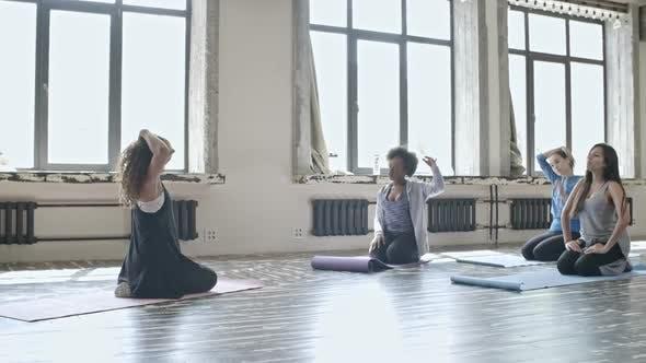 Thumbnail for Women Warming Up in Yoga Class
